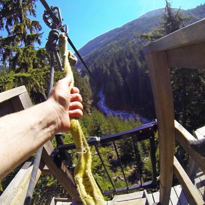 Sara getting ready to fly over Fitzsimmons Creek on a zipline near Whistler